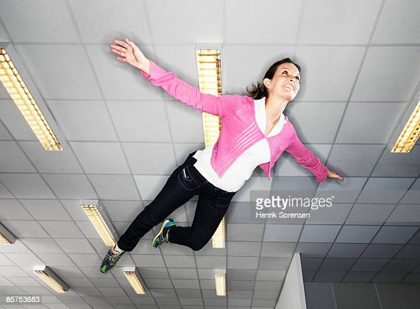 Woman floating under the ceiling.