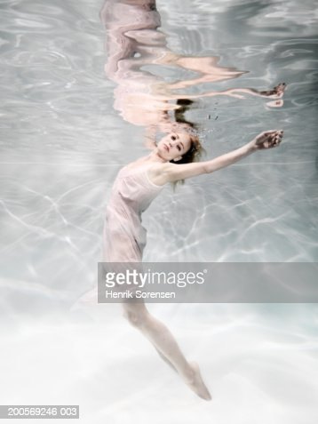 Woman floating under water : Stock Photo