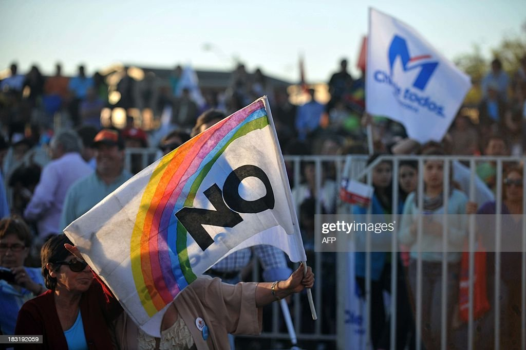 A woman flutters a flag reading 'No' during the 'Concert For Democracy' in Santiago, on October 5, 2013, on the 25th anniversary of the plebiscite of 1988. On October 5, 1988, it was decided through a plebiscite that former Chilean dictator (1973-1990) Augusto Pinochet (1915-2006) would not continue in power until March 11, 1997. AFP PHOTO/Hector RETAMAL