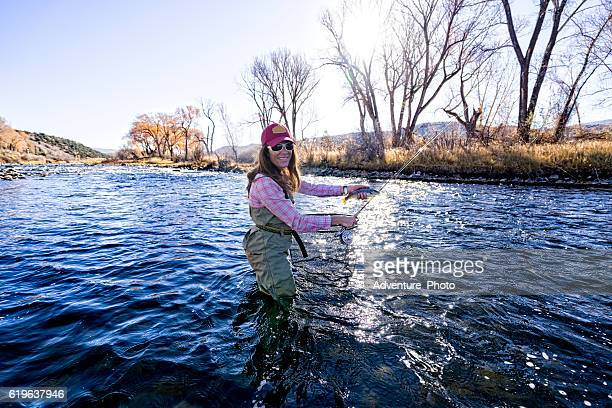 Woman Fly Fisher Holding a  Fish