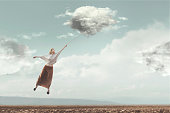 woman flying in the sky carried by a cloud