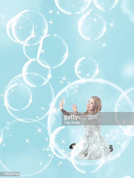 Woman flying in the sky in the bubble