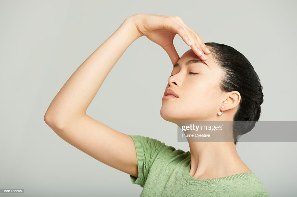 Woman for hand on her head : Stock Photo