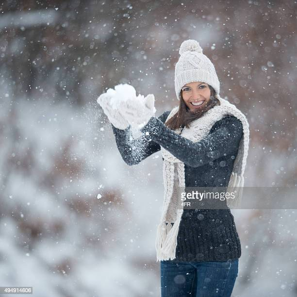 Woman forming a Snowball