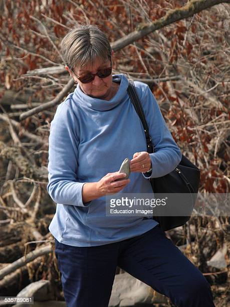 Woman fossil hunting Lyme Regis Dorset UK
