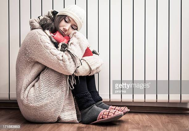 Woman freezing at home