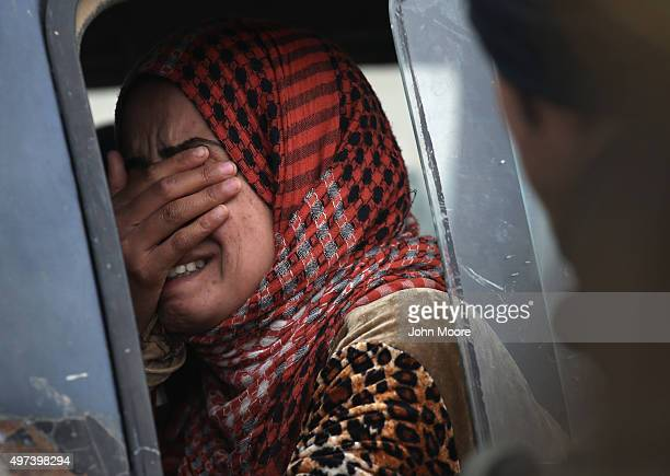 A woman from an Arabic family cries after her family was rejected to enter a Kurdishcontrolled area from an ISISheld village on November 16 2015 near...