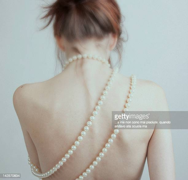 Woman from behind with pearl necklace