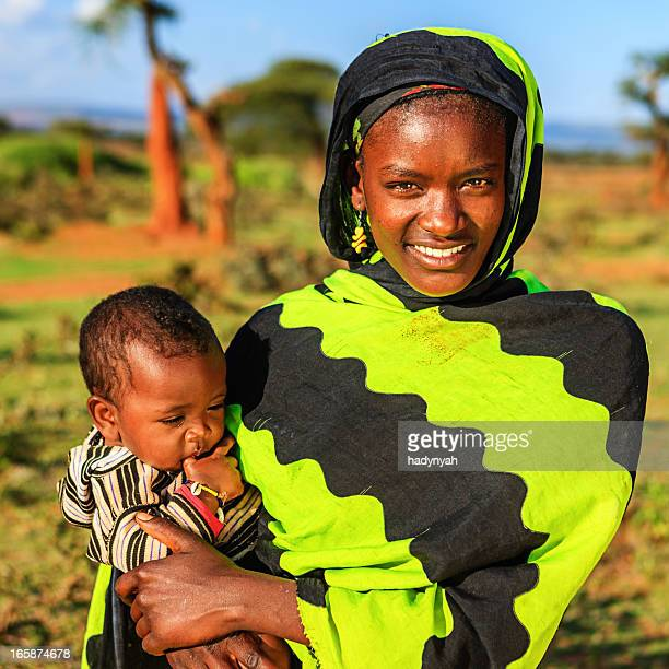 Woman from Borana tribe carrying her baby, Ethiopia, Africa