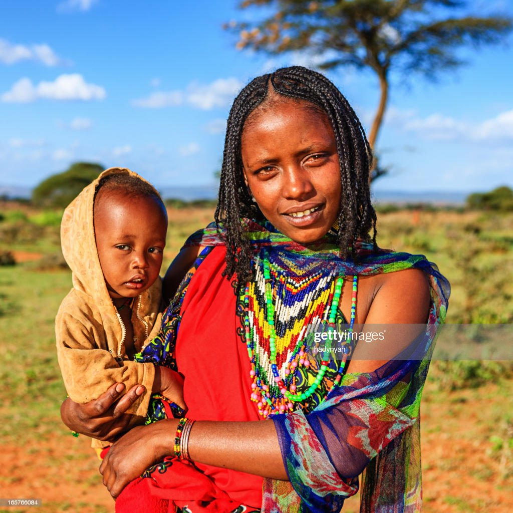 Woman from Borana tribe holding her baby, Ethiopia, Africa : Stock Photo