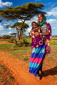 'Woman from Borana tribe holding her baby, Ethiopia, Africa'