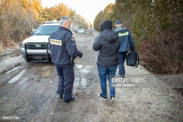 A woman from Eritrea speaks with RCMP officers after illegally crossing the USCanada border near Hemmingford Quebec February 28 2017 / AFP / Geoff...