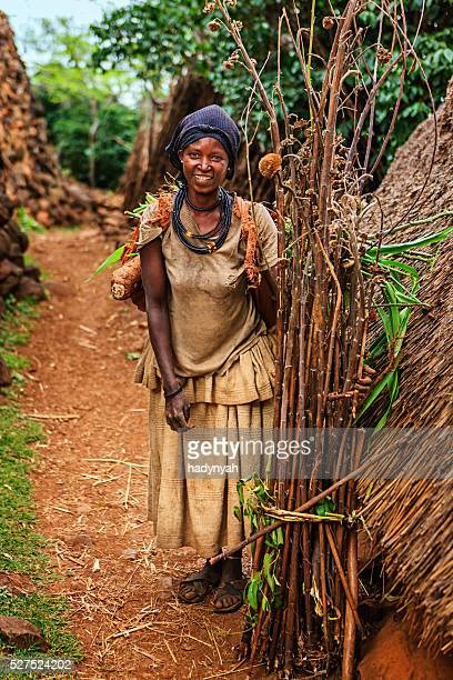 Woman from Konso tribe carrying brushwood, Ethiopia, Africa