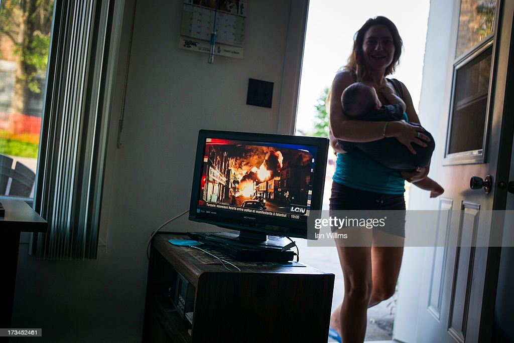 A woman from Montrial visit the home of a local resident who lives about 100 metres from the crash site, on July 13, 2013 in Lac-Megantic, Quebec, Canada. A train derailed and exploded into a massive fire that flattened dozens of buildings in the town's historic district, leaving 60 people dead or missing in the early morning hours of July 6.