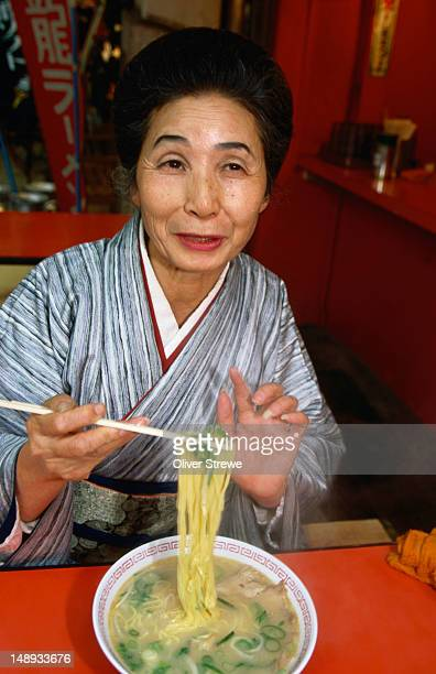 A woman from Osaka enjoys a bowl of noodles from the Kinryu Ramen Noodle Shop.