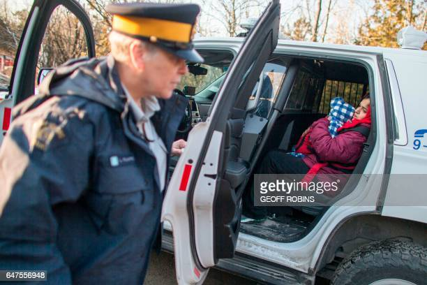 A woman from Pakistan is arrested by RCMP officers after she and her family illegally crossed the USCanada border near Hemmingford Quebec February 28...