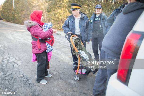 A woman from Pakistan speaks with RCMP officers after she and her family illegally crossed the USCanada border near Hemmingford Quebec February 28...