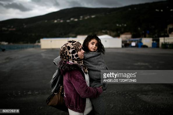 A woman from Syria holds her baby as she arrives at the registration centre on the Greek island of Samos after being rescued by the charity Migrant...