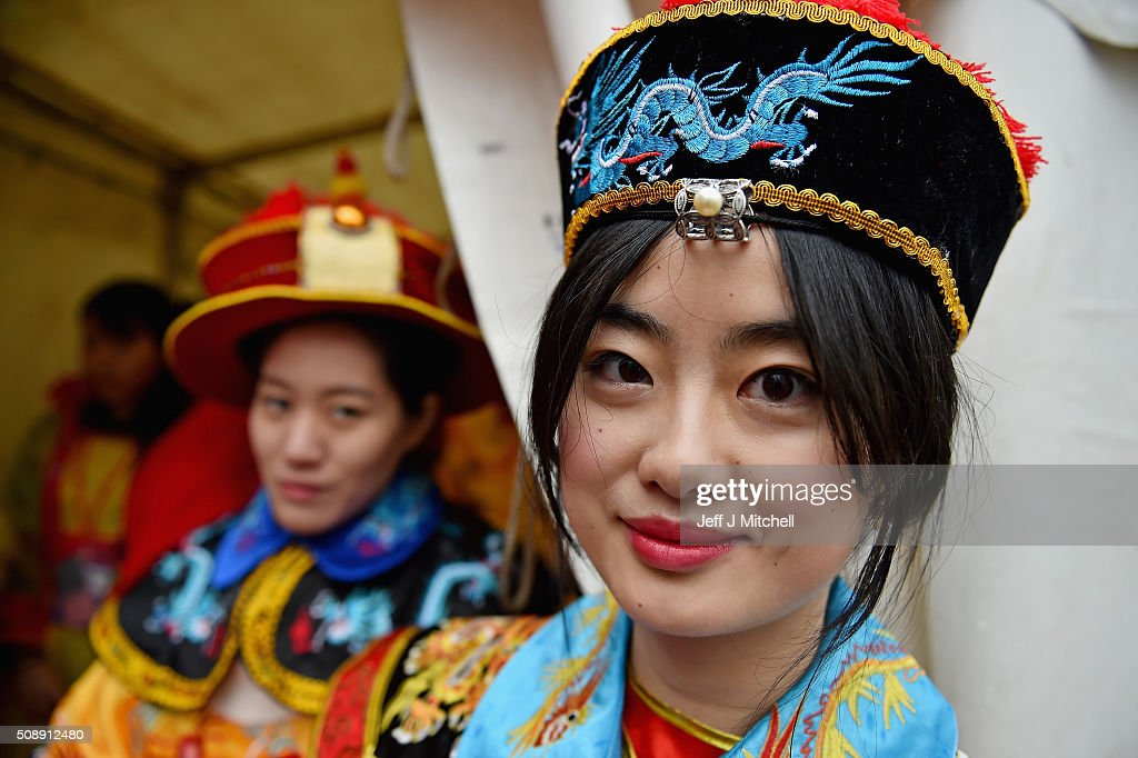 A woman from the Chinese community of Glasgow is dressed in traditional costume celebrate The Year of The Monkey on February 7, 2016 in Glasgow, Scotland. The first ever Chinese New Year celebrations to be held in George Square, The Year of the Monkey begins on February 8th and lasts until January 27, 2017.