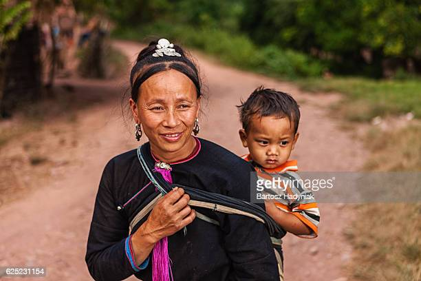 Woman from the hill tribe carrying her baby
