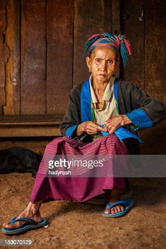 Woman from the hill tribe sewing a pillow : Stock Photo