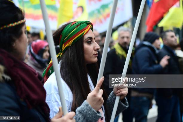 A woman from the Kurdish community holds a flag as she marches during a demonstration to ask Turkey to release Kurdistan Worker's Party leader...