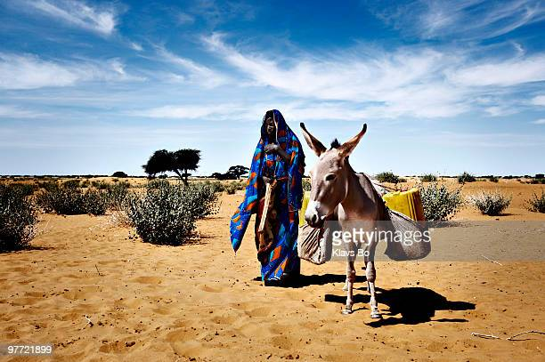 A woman from the village Nguel Hanagambjo on her way to a well to collect water Wells For Peace is a 5year project which is part of a CARE Denmark...