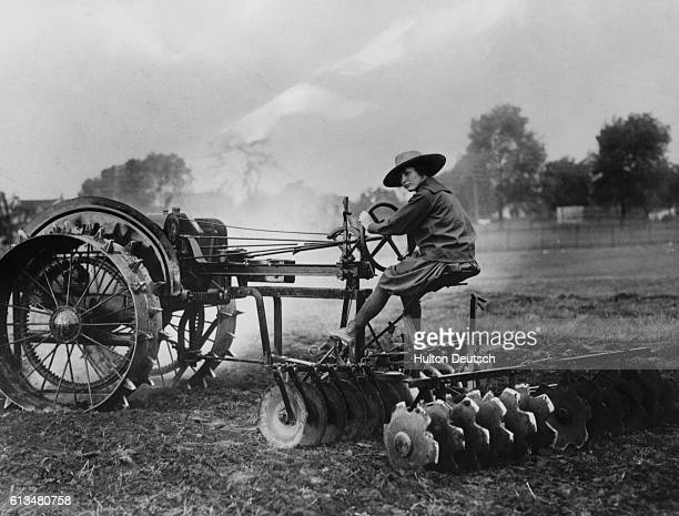 A woman from Vassar College plows a field as part of the war effort 1917