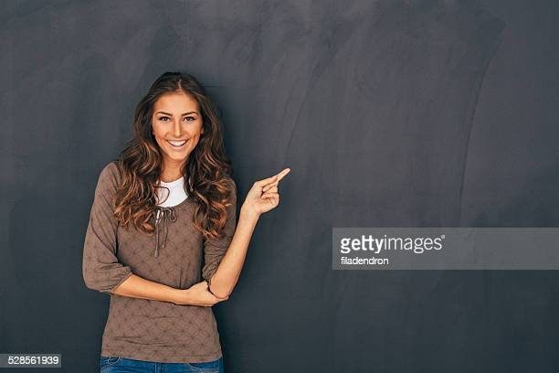 Woman Front of Blackboard