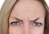 woman frowns forehead