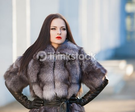 Woman Fur Coat And Black Leather Gloves Stock Photo | Thinkstock