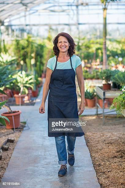 Woman garden centre owner