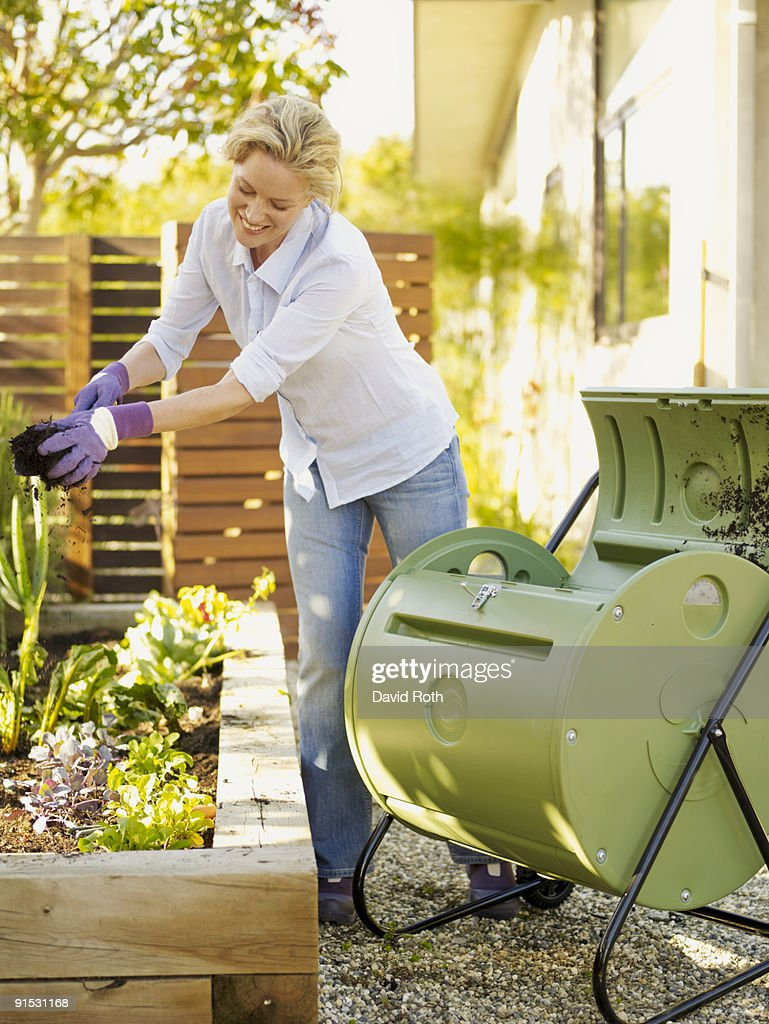 woman gardening & composting : Stock Photo