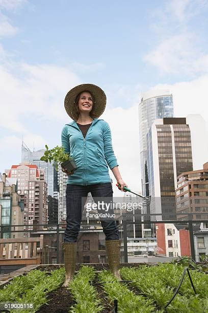 Woman gardening on roof