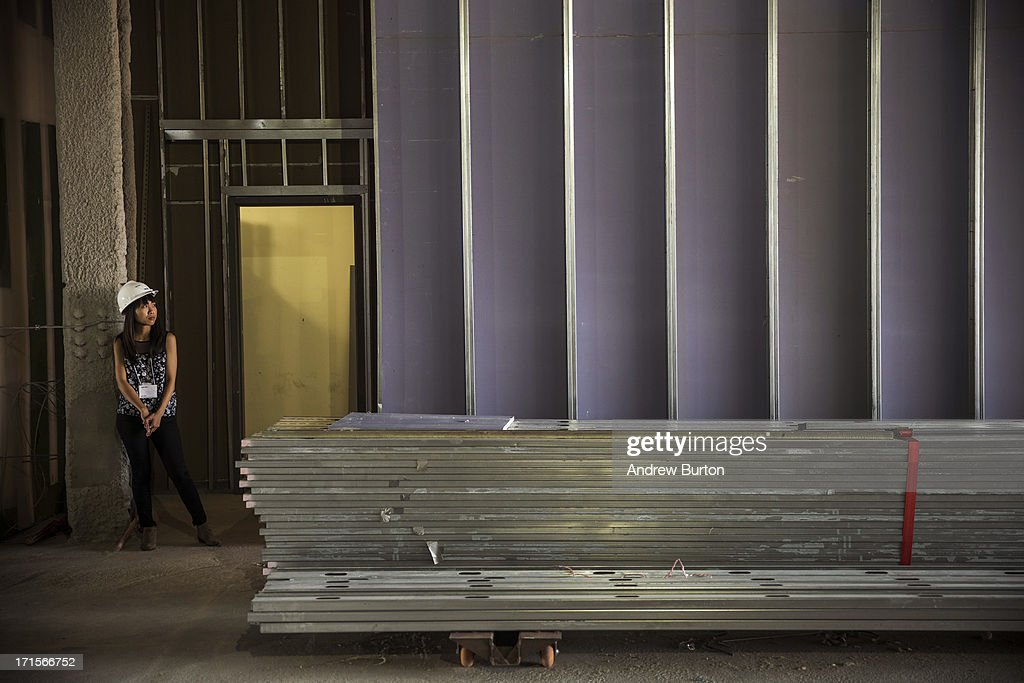 A woman gazes at the Whitney Museum of American Art's new building, which is still under construction, on June 26, 2013 in the Meat Packing District neighborhood of New York City. The museum, which is scheduled to open in 2015, will be nine stories tall and was designed by Renzo Piano Building Workshops. The estimated capital campaign, including building cost, endowments and the increase of instituional capacity, is $760 million.