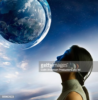 Woman gazing at planet : Stock Photo