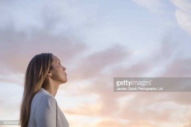 Woman gazing at sky