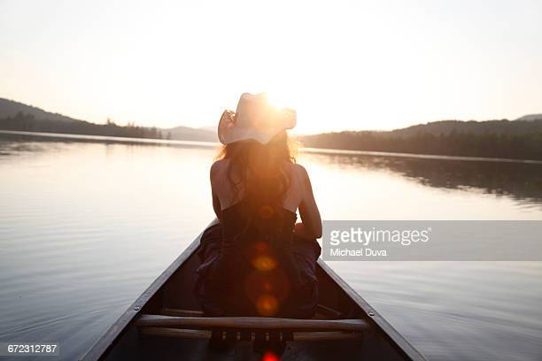 woman gazing upon a light-drenched lake