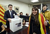 A woman gestures as she casts her ballot at a polling station in the Delegation of the Catalan Government in France on November 9 2014 in Paris...