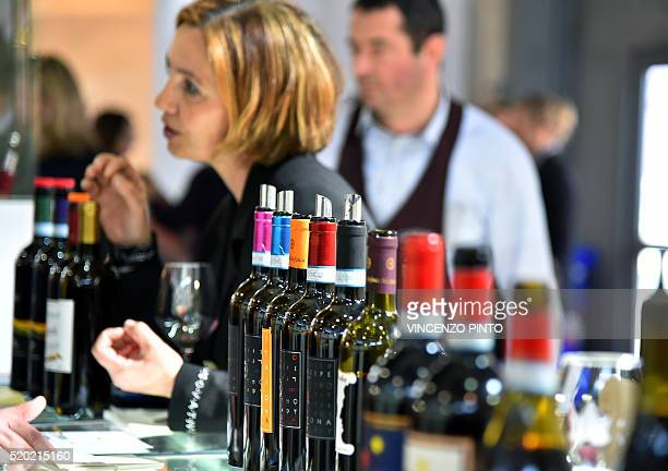 A woman gestures as she tastes wine on April 10 2016 during the 50th edition of the Vinitaly wine exhibition in Verona Vinitaly is the worlds largest...