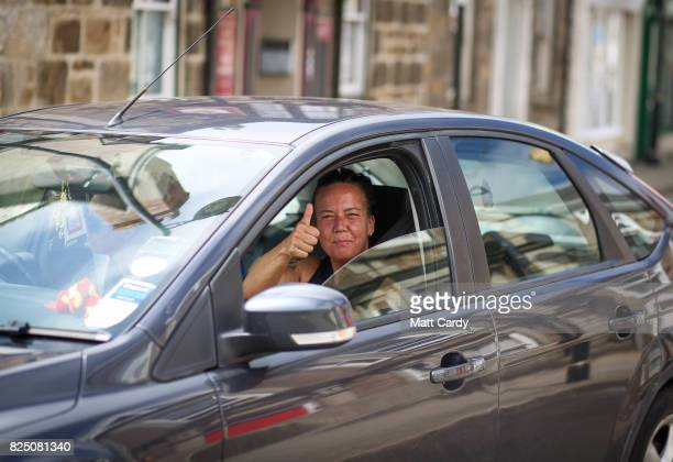 A woman gestures from a car as she drives through Camborne on July 24 2017 in Cornwall England Figures released by Eurostat in 2014 named the British...