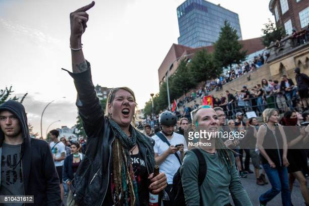 A woman gestures towards the police during the 'Welcome to Hell' antiG20 protest march on July 6 2017 in Hamburg Germany Leaders of the G20 group of...