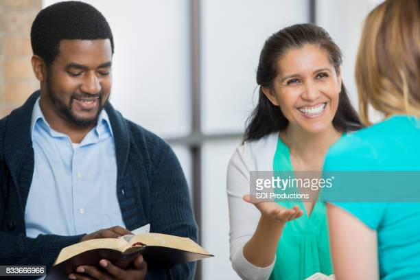 Woman gestures while discussing something during Bible study