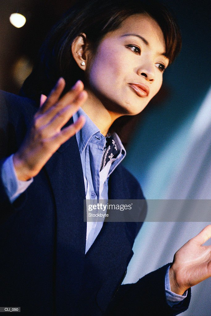 Woman gesturing with raised hands : Stock Photo
