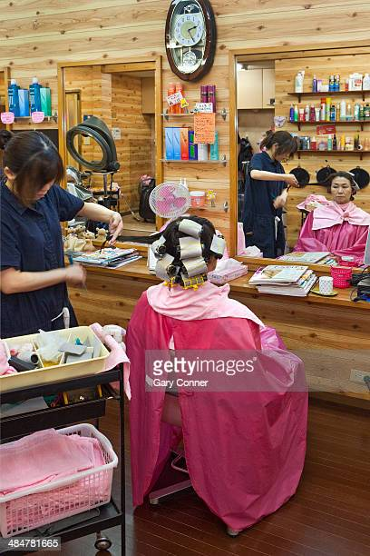 Woman gets her hair styled