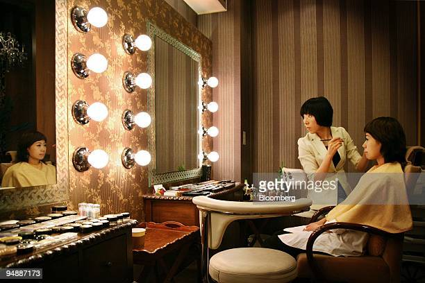 A woman gets her makeup done at a beauty salon in Seoul South Korea on Wednesday May 28 2008 Banks and retailers are rolling out products catering to...