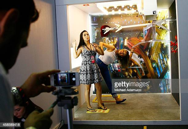 A woman gets her picture taken in an Instagram booth during Sao Paulo Fashion Week Winter 2015 at Parque Candido Portinari on November 7 2014 in Sao...