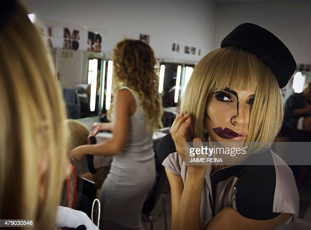A woman gets ready for her performance at the backstage of the Heart restaurant in Ibiza on June 29 2015 Take the Spanish chefs Ferran and Albert...