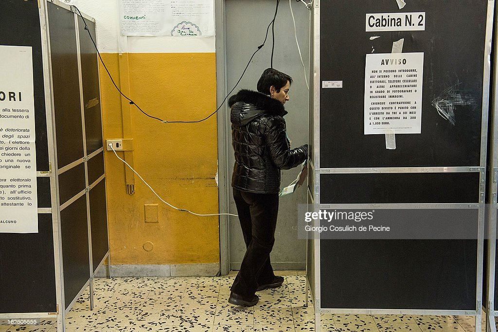 A woman gets ready to cast her ballot at a polling station on February 24, 2013 in Rome, Italy. Italians are heading to the polls today to vote in the elections, as the country remains in the grip of economic problems . Pier Luigi Bersani's centre-left alliance is believed to be a few points ahead of the centre-right bloc led by ex-Prime Minister Silvio Berlusconi.