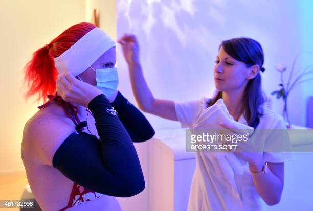 A woman gets ready to undergo a 'whole body cryotherapy' session at 110 degrees Celsius below zero at the 'Kemijoki' Cryotherapy Center in Rennes...